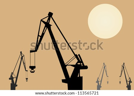 Vector drawing. Cranes at sunset