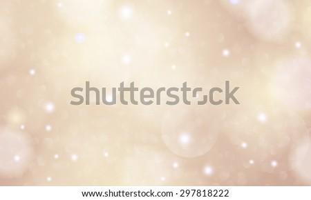 Vector glittering stars on golden glittering Christmas background.