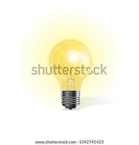 Vector glowing light bulb. - Shutterstock ID 1042741423