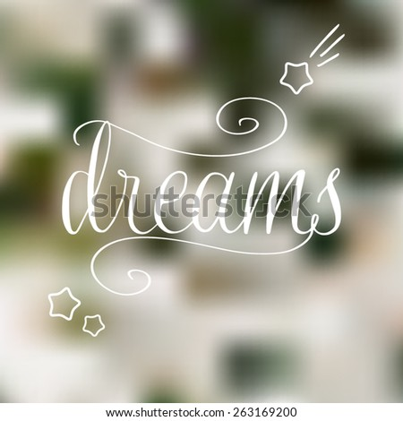 vector hand drawn dreams phrase on the nature blurry background