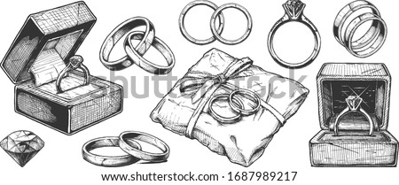 Vector hand drawn illustration of different wedding jewelry rings in vintage engraved style. isolated on white background. stock photo