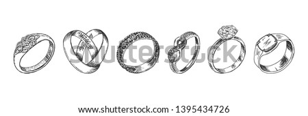 Vector hand drawn illustration of jewelry wedding and engagement rings set in vintage engraved style. Isolated on white background. Foto d'archivio ©