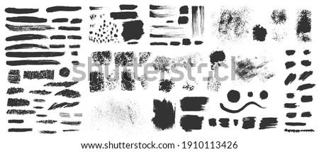 Vector hand drawn ink design elements. Sponge stamps, dry brush marks, splatter sprinkles, pastel pencil textures. Set of grunge black artistic brushstroke design elements isolated on white background