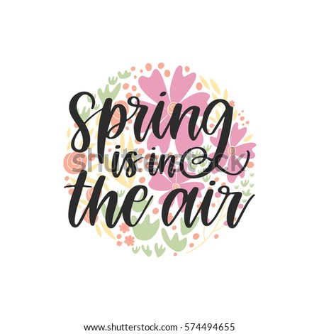 Vector hand drawn motivational and inspirational season quote - Spring is in the air.Calligraphic poster with hand drawn flowers in a shape of circle