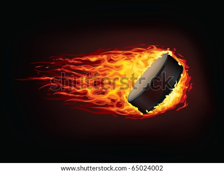 Vector hockey puck in enveloped in fire flames isolated on black background.