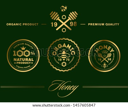 Vector honey vintage logo and icons for honey products, apiary and beekeeping branding and identity. Gold honeycombs. Luxury gold badges and labels premium quality product. Premium honey stamps.