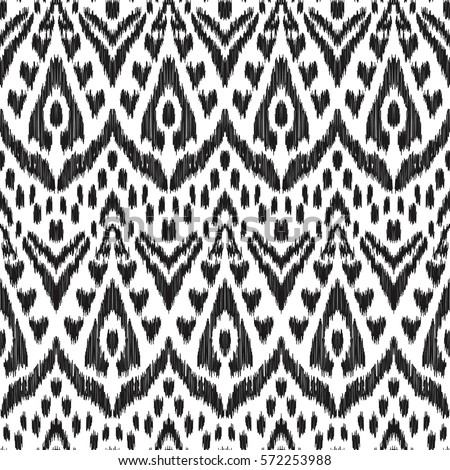 Vector Ikat seamless pattern. Bohemian ornament. Fashion textile, cloth, fabric, wallpaper, card, wrapping paper. Creative hippies print. Stylish ethnic backdrop. Boho chic style. Hipster design.