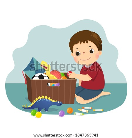 Vector illustration cartoon of a little boy putting his toys into the box. Kids doing housework chores at home concept. Stock photo ©