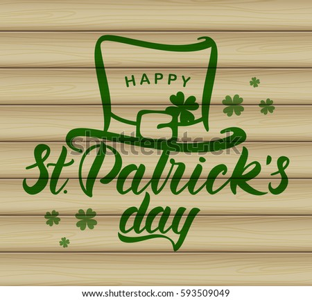Vector illustration: Hand drawn brush lettering of Happy St. Patrick's Day with leprechaun hat on wood background. Typography design.