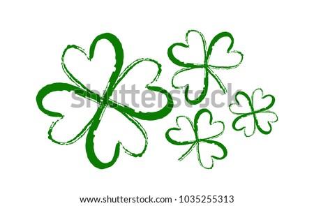 Vector illustration: Hand drawn brush shamrocks on white background. Sketch line clover.