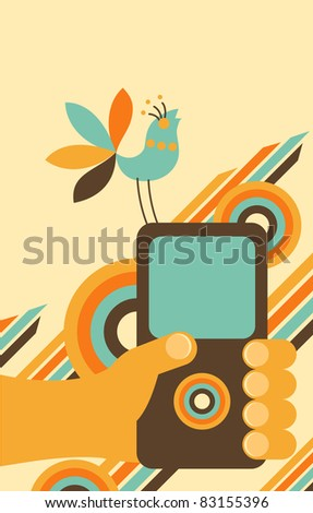 Vector illustration - hand holding mobile / cell phone. On the phone sitting  blue bird