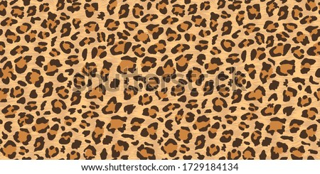 Vector illustration of a leopard. Seamless wild animal skin with print