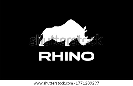 Vector illustration of a silhouette of a rhino standing on isolated white background. Rhinoceros side view profile. Сток-фото ©