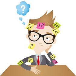 Vector illustration of a speculating cartoon businessman sitting at desk with sticky notes all over him (JPEG also available).