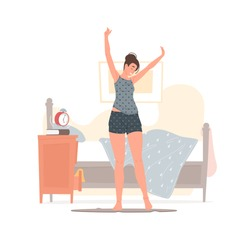 Vector illustration of cheerful young female in pajama raising arms and stretching body while standing near bed and cabinet with ringing alarm clock in morning at home. Flat style cartoon character