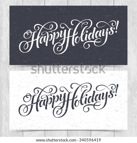 Vector illustration of paper cards with Happy Holidays lettering and ornamental elements. Christmas calligraphy on wood background.