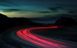 Vector image of a long-term exposure to light vehicles on a freeway against a background of colorful sunset