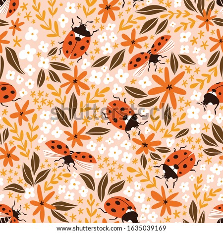 Vector insect seamless pattern. Hand-drawn ladybugs and flowers on the pink background. Summer ditzy floral pattern. Сток-фото ©