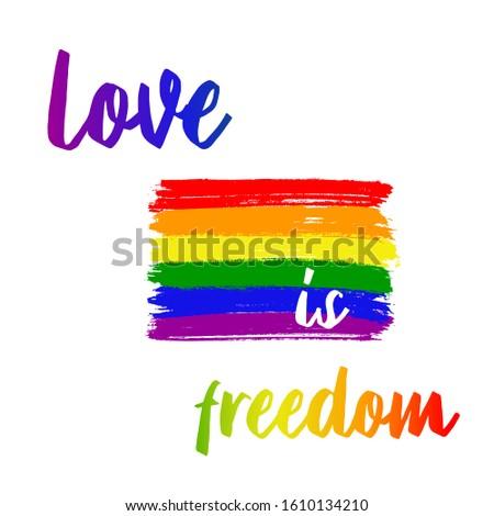 "Vector lgbt flag paint strokes. Paint strokes in rainbow colors. The inscription ""Love is freedom"""