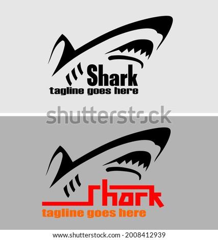 Vector logo of a ferocious and dashing shark Stock photo ©