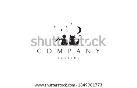 Vector logo on which an abstract image of a little prince with a fox under the starry sky. ストックフォト ©