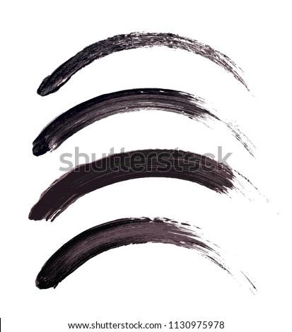 Vector make-up cosmetic mascara brush stroke texture design isolated on white. Realistic mascara smear set template. Mascara eyelashes brush stroke makeup. Black hand drawn lash scribble swatch.