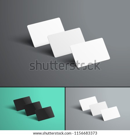 Vector Mockup  of three gift or bank cards with shadows standing with a row one after another. A realistic template of black and white on colored backgrounds. Set