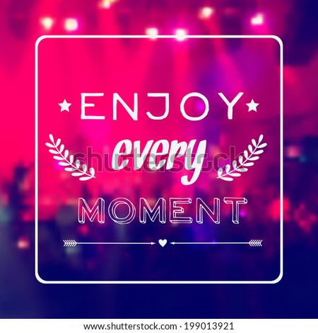 Vector motivational card Enjoy every moment Blurred background with rock stage and crowd