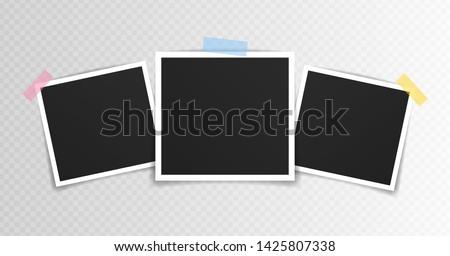 Vector Photo frame mockup design. Photo frame on sticky tape isolated on transparent background. Vector illustration. Foto stock ©