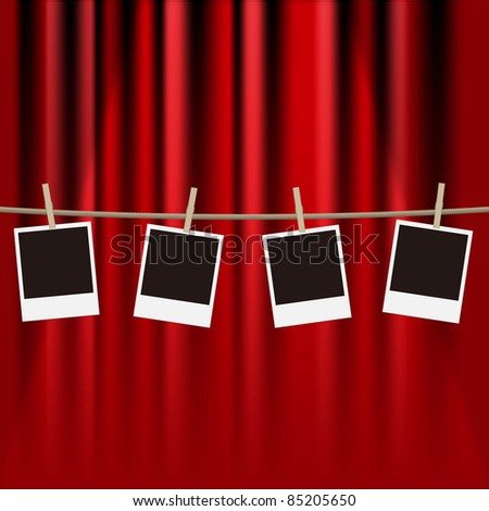 vector photo frames hanging from a clothes line on a red curtain
