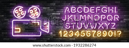Vector realistic isolated neon sign of Camera logo with easy to change color font alphabet on the wall background. Concept of photographer profession, cinema studio and creative process.
