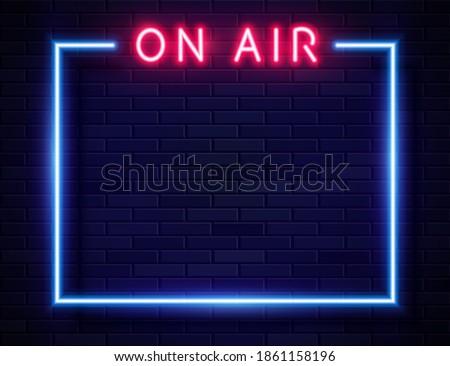 Vector Retro Neon Red On Air Frame on Dark Empty Grunge Brick Background. Vintage Neon Style Blue Frame ストックフォト ©