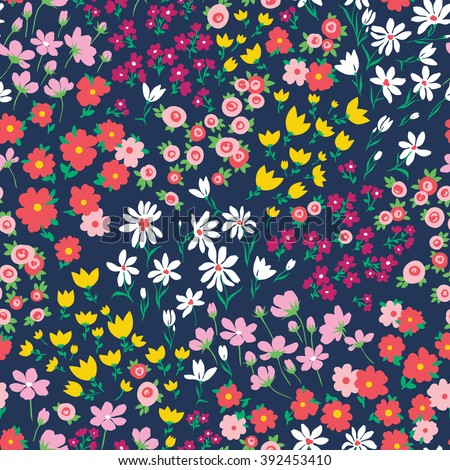 vector seamless bright colorful gentle hand drawn little ditsy flower pattern, summer garden, wildflowers, vibrant floral allover print on dark blue background