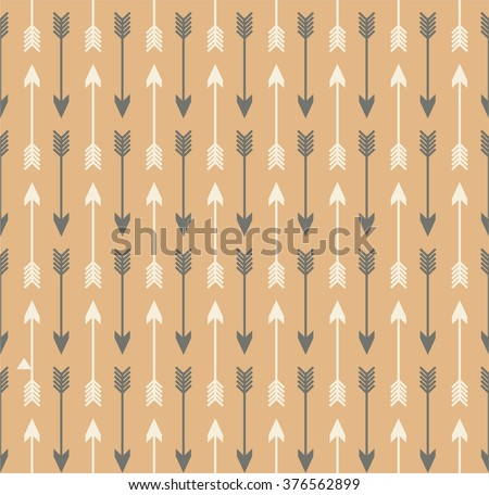 Vector seamless colorful ethnic pattern with arrows. Seamless pattern in native american style.Tribal arrows on brown kraft background