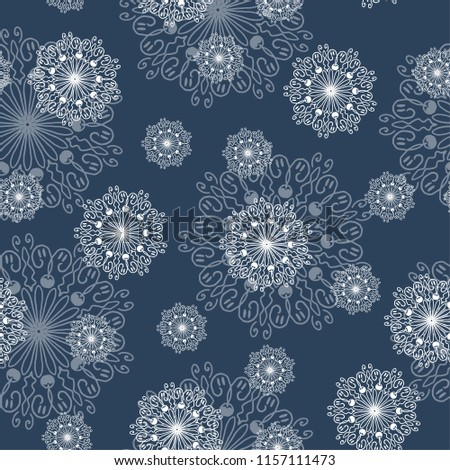 Stock Photo vector seamless eastern pattern with  ornament mandala snowflake in winter in December for holiday christmas and new year white on a blue background for printing and textiles