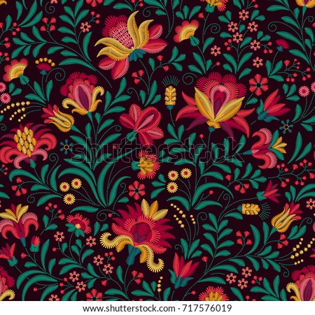 Vector seamless pattern. Floral background in vintage style. Decorative embroidery flowers. Ornament for textiles on black background. Colorful flowers. The elegant the template for fashion prints.