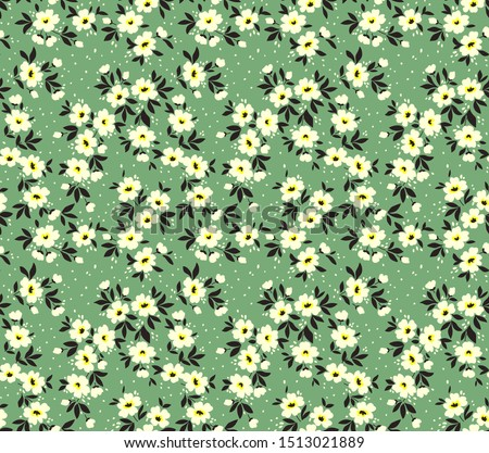 Vector seamless pattern. Pretty pattern in small flower. Small white flowers. Pale green background. Ditsy floral background. The elegant the template for fashion prints.