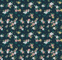Vector seamless pattern. Pretty pattern in small flowers. Small pink and white flowers. Dark blue background. Ditsy floral background. The elegant the template for fashion prints.