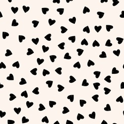 Vector seamless pattern. Simple hipster background with hand drawn hearts.