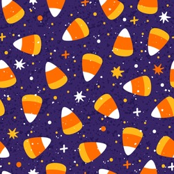 Vector seamless pattern with Halloween candy corn cones. Bright repeated texture with sweets. Holiday background with candy.