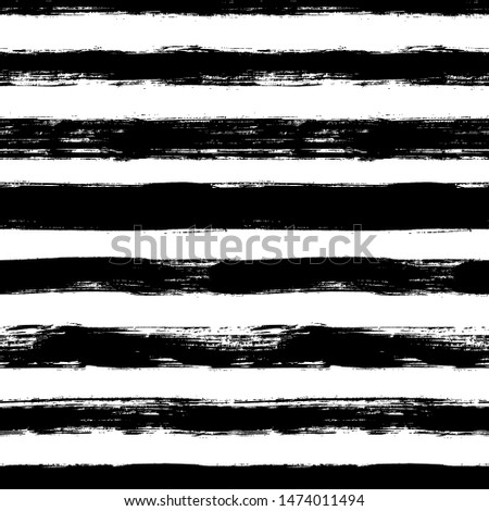 Vector seamless pattern with scribbles stripes. Ink brush texture. Simple monochrome background. Ornament for wrapping paper, wallpapers, web design etc. Modern monochrome background.