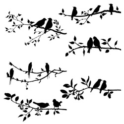 vector set of birds at trees silhouettes, hand drawn songbirds at branches, isolated vector elements