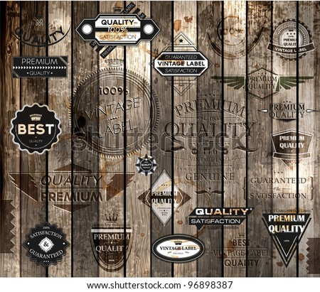 vector set of calligraphic design elements, page decoration, Premium Quality and Satisfaction Guarantee Label collection, Vintage wood background - stock vector