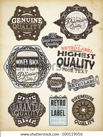 Vector set of calligraphic design elements: page decoration, Premium Quality, Genuine and Highest Quality Labels | Old paper texture with dirty footprints of a cup of coffee.