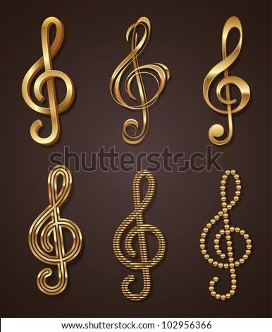 Vector set of golden decorative treble clef