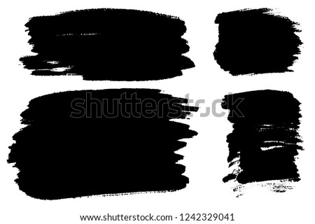 Vector set of hand drawn brush strokes, stains for backdrops. Monochrome design elements set. Black color artistic hand drawn backgrounds. #1242329041