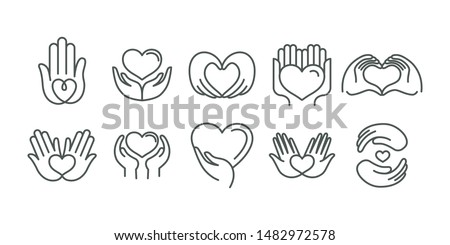Vector set of logo design templates in simple linear style - hearts and hands - charity and volunteer organisations emblems and handmade businesses  Photo stock ©