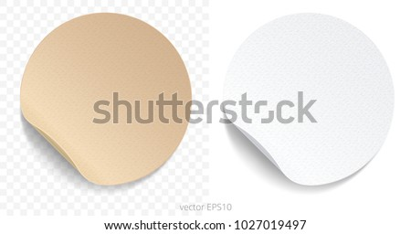 Vector set of round adhesive stickers with a folded edges. Tan cardboard and white paper circles. Blank templates of a price tags. Empty mockup for any memos. Realistic textures. Transparent shadows. #1027019497
