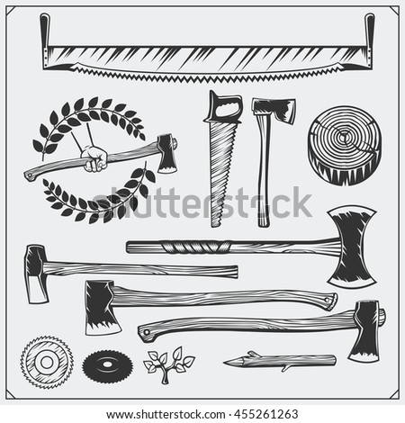 Vector set of vintage carpentry tools. Axes and saws.