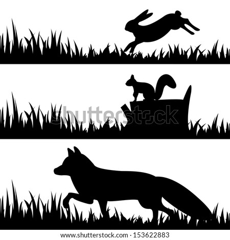 Vector set silhouettes of animals in the grass.